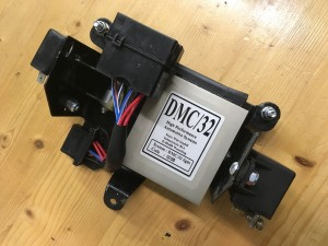 Original ignition box mount , now with (from left) flasher unit, fuse box, ignition box and solenoid