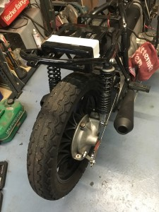 The existing battery tray fouled the rear tyre when the shocks compressed