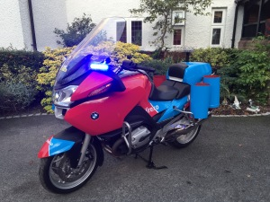 Flashing blue lights are controlled from a handlebar switch