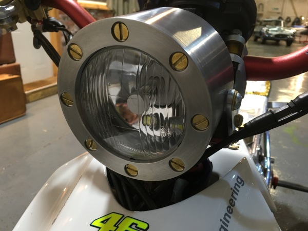 Machined aluminium headlight with brass screws and an LED bulb