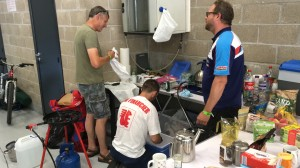 Peter Boast (left) and Guy Martin doing the washing up at the back of the pit garage. Jez (right) is telling them to get a move on