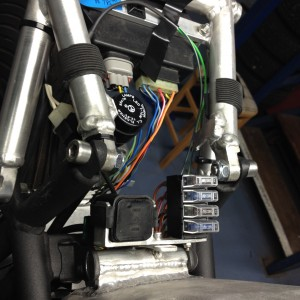 Most of the electrics have to live under the seat